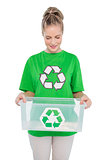 Smiling environmental activist holding recycling box