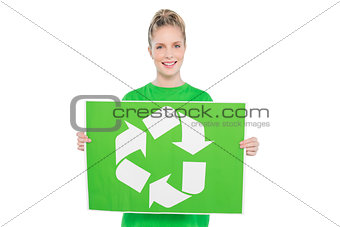 Smiling blonde environmental activist holding recycling sign