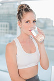 Beautiful athletic blonde drinking water