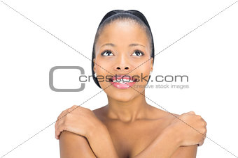 Smiling black woman looking upwards