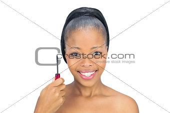 Smiling woman showing her mascara