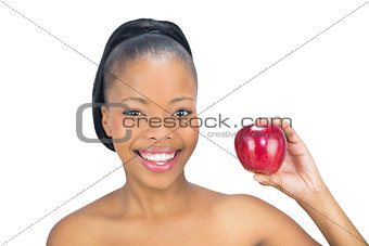 Attractive woman holding red apple