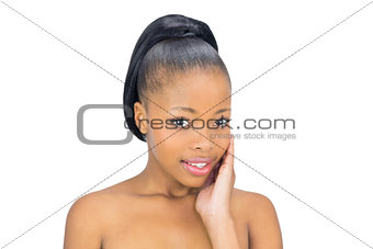 Attractive woman holding her face