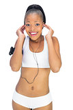 Happy woman in sportswear listening to music