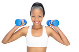 Sporty woman working out with dumbbells