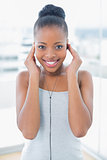 Attractive slender woman listening to music