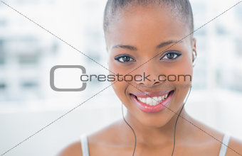 Close up of woman listening to music