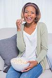 Laughing woman eating popcorn
