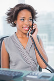 Cheerful businesswoman talking on phone