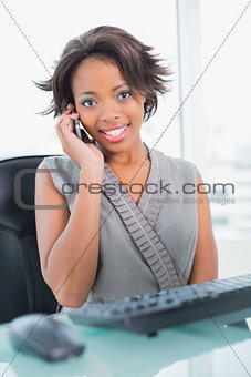 Attractive businesswoman calling on phone