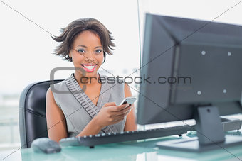 Attractive businesswoman texting