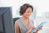 Happy businesswoman using tablet pc