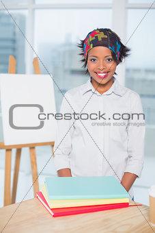 Smiling artist standing in her studio