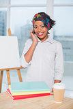Happy artist talking on phone