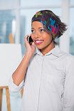 Attractive artist talking on phone