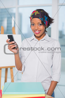 Smiling artist texting