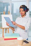 Focused artist using tablet