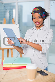 Smiling artist using tablet