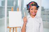 Smiling artist showing her brush