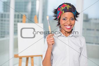 Smiling artist showing her brush