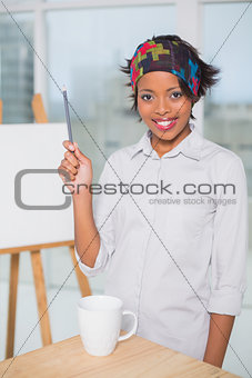 Smiling artist holding a pen