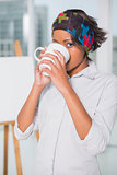 Artistic woman drinking a coffee
