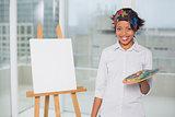 Smiling artist holding palette