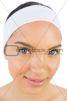 Close up view of attractive woman wearing a headband and looking at camera
