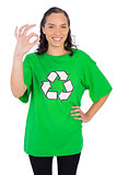 Pretty woman wearing green recycling tshirt showing okay sign