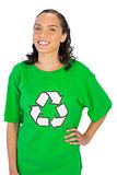 Happy woman wearing green recycling tshirt posing