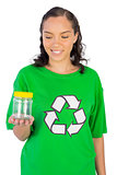 Smiling woman wearing green recycling tshirt holding jar