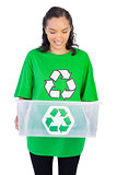 Brunette woman holding a recycling box