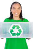 Smiling woman giving a recycling box to the camera