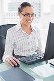 Cheerful businesswoman working on computer
