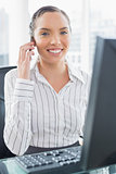 Attractive smiling businesswoman talking on phone