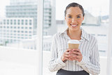 Cute businesswoman holding a coffee