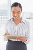 Stylish businesswoman using a tablet pc