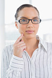 Thoughtful businesswoman wearing reading glasses