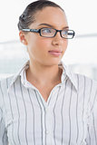 Pretty businesswoman with reading glasses