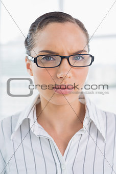 Angry businesswoman with reading glasses