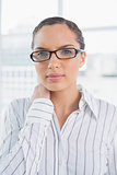 Content businesswoman with reading glasses