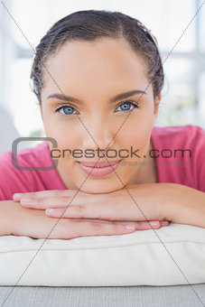 Portrait of attractive woman lying on sofa