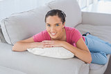 Peaceful woman lying on the sofa