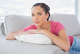 Attractive woman lying on sofa