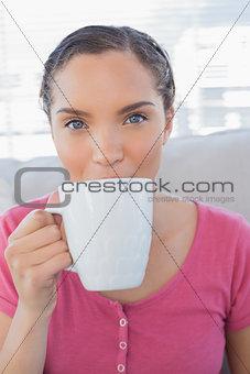 Portrait of happy woman drinking a coffee