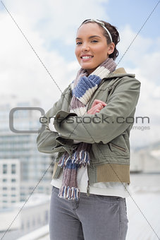 Portrait of smiling woman crossing her arms