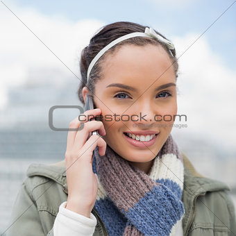 Close up view of attractive woman talking on phone