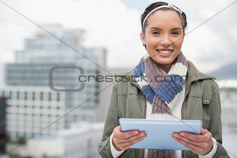 Close up of smiling woman using tablet