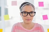 Serious woman with glasses in creative office