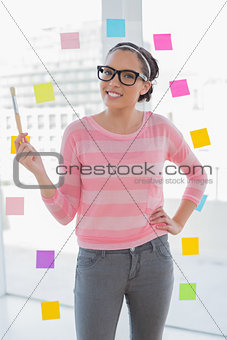 Smiling artist holding brush and looking at camera
